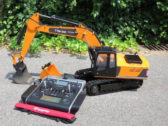 TTM-Bagger Vorführmodell orange/schwarz mit Schnellwechsler